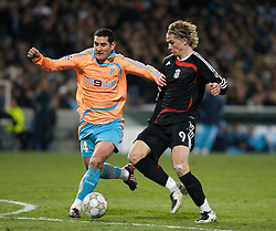 MARSEILLE, FRANCE - Tuesday, December 11, 2007: Liverpool's Fernando Torres and Olympique de Marseille's Julien Rodriguez during the final UEFA Champions League Group A match at the Stade Velodrome. (Photo by David Rawcliffe/Propaganda)