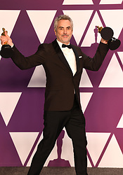 """Alfonso Cuaron, winner of the Best Director Award, Best Foreign Film Award and Best Cinematography Award for """"Roma"""" at the 91st Annual Academy Awards"""