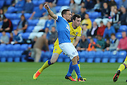 AFC Wimbledon defender Sean Kelly (22) and  Peterborough United striker Paul Taylor (10) during the EFL Cup match between Peterborough United and AFC Wimbledon at ABAX Stadium, Peterborough, England on 9 August 2016. Photo by Stuart Butcher.