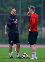 NANNING, CHINA - Saturday, March 24, 2018: Wales' new manager Ryan Giggs and Lee Evans during a training session at the Guangxi Sports Centre ahead of the 2018 Gree China Cup International Football Championship final match against Uruguay. (Pic by David Rawcliffe/Propaganda)