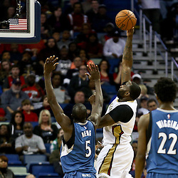 Feb 27, 2016; New Orleans, LA, USA; New Orleans Pelicans center Kendrick Perkins (5) shoots over Minnesota Timberwolves center Gorgui Dieng (5) during the first half of a game at  the Smoothie King Center. Mandatory Credit: Derick E. Hingle-USA TODAY Sports