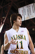 November 25th, 2010:  Anchorage, Alaska - University of Alaska-Anchorage guard Travis Thompson (11) in the Seawolves 54-86 loss to Weber State in the first round of the Great Alaska Shootout.