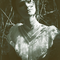 atmospheric photo of beautiful young caucasian woman looking aside in retro style in wedding dress