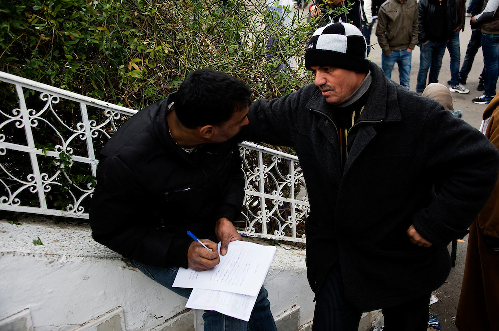 January 2016, Kasserine, Tunisia. Unemployed people filling in the application forms to apply for a job to the regional headquarters of the Kasserine Governate which is  under siege  for over a week by unemployed people.