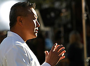 Peter Rhee, medical director of University Medical Center's Trauma and Critical Care unit where congresswoman Gabrielle Giffords was treated talks to reporters at a memorial outside the hospital where victims of the shootings are recovering in Tucson, Arizona January 10, 2011.   REUTERS/Rick Wilking (UNITED STATES)
