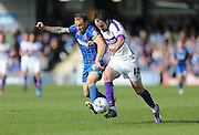 Oxford United striker Danny Hylton and Wimbledon defender BARRY FULLER during the Sky Bet League 2 match between AFC Wimbledon and Oxford United at the Cherry Red Records Stadium, Kingston, England on 11 April 2015.