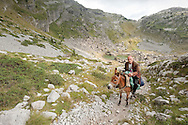 Peaks of the Balkans Trail, Albania. Man on a donkey, near the Pejë Pass (Qafa e Pejës) leading to Theth. © Rudolf Abraham