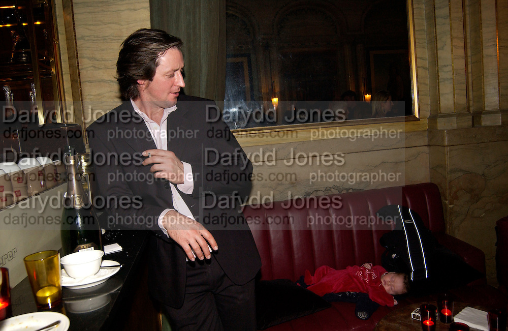 Saoirse Clune and dad, Krug Christmas party, hosted by Sir Trevor Nunn and Imogen Stubbs, the Criterion, 10 December 2003. © Copyright Photograph by Dafydd Jones 66 Stockwell Park Rd. London SW9 0DA Tel 020 7733 0108 www.dafjones.com