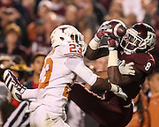 Nov 24, 2011; College Station, TX, USA; Texas Longhorns cornerback Carrington Byndom (23) breaks up a pass intended for Texas A&M Aggies wide receiver Jeff Fuller (8) during the second quarter at Kyle Field. Texas won 27-25. Mandatory Credit: Thomas Campbell