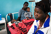 "A mother  watches over her twin sons who are being re-hydrated with intravenous fluids on a paediatric ward at a Cholera Treatment Centre in Harare...Children and adults are treated at Beatrice Road Infectious Diseases Clinic in Harare, Zimbabwe...The clinic is staffed by locals but assisted by MSF. As of 30 May 2009, there were 98 424 suspected cases, including 4 276 deaths reported by the Ministry of Health and Child Welfare (MoHCW) of Zimbabwe since August 2008. Fifty-five out of 62 districts in all 10 provinces were affected. in December 2008, Robert Mugabe declared that ""there is no cholera"" in Zimbabwe. Failing sanitation and lack of water supply were to blame, workers responsible claimed they had not been paid by the government for several months."