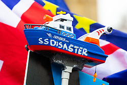 "A toy boat dubbed ""SS Disaster"", a jibe at the Government's awarding of a contract in the event of a hard Brexit to a ferry company that has no ships, is taped to a pole used by anti-Brexit and People's Vote Campaigner Steve Bray to disrupt TV broadcasts on College Green outside Parliament where small numbers of both both Remain and Leave protesters are demonstrating. London, January 07 2019."