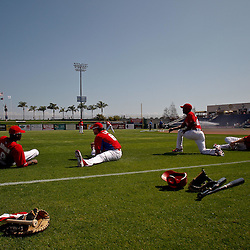 February 24, 2011; Clearwater, FL, USA; Philadelphia Phillies players stretch prior to a spring training exhibition game against the Florida State Seminoles at Bright House Networks Field. The Phillies defeated the Seminoles 8-0. Mandatory Credit: Derick E. Hingle