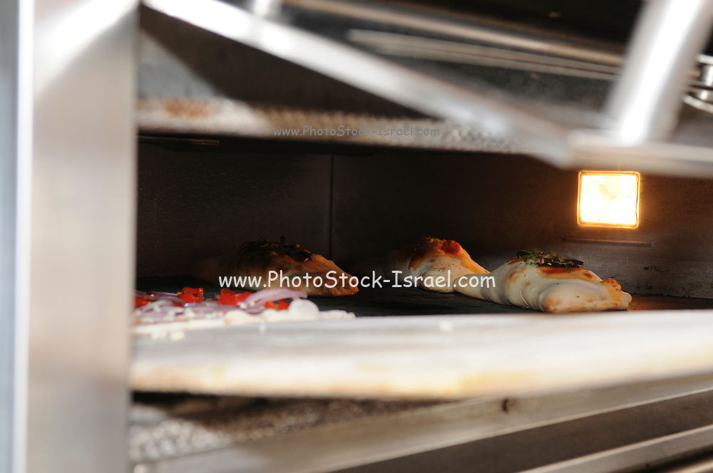 calzone baking in an oven