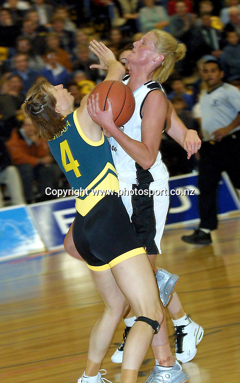 Donna Loffhagen and Jo Hill in action during the womens international basketball match between the Tall Ferns and Australia, 14 September, 2001 at Southland Stadium, Invercargill, New Zealand. Photo: Chris Skelton/PHOTOSPORT<br /><br /><br /><br />039835 *** Local Caption ***