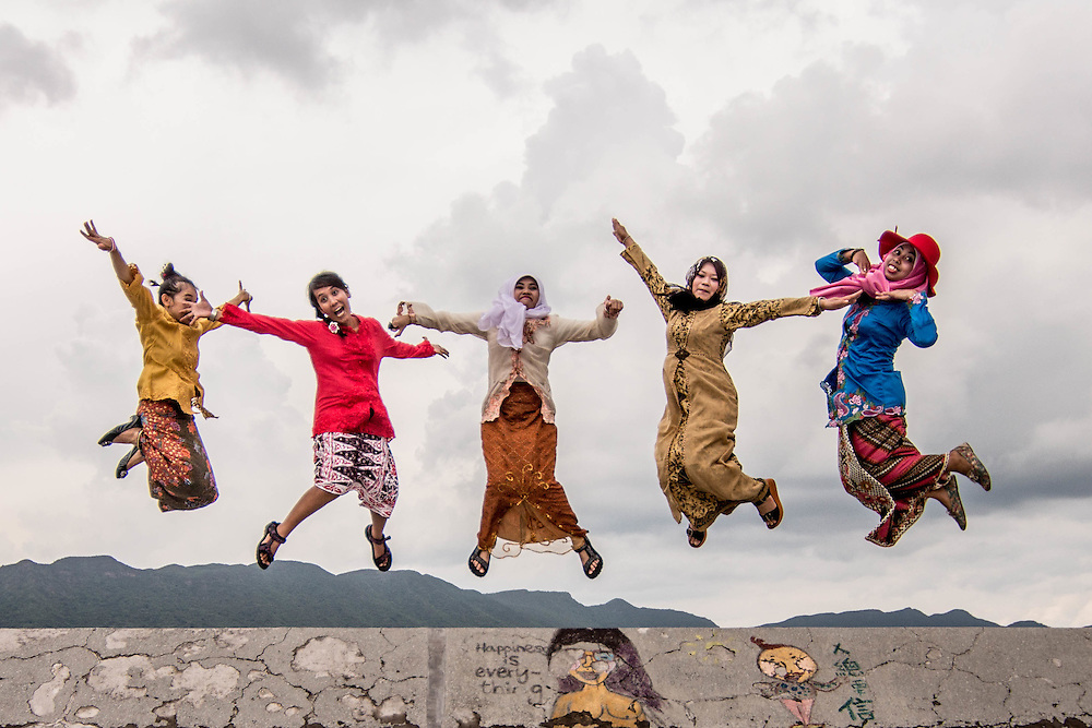 Empowerment, Hong Kong by Asti Maria.<br /> <br /> A group of Indonesian domestic workers jump in joy and anticipation, to defy the stereotype of Muslim women, in Hong Kong. <br /> <br /> Asti is 34 years old, and she has been in Hong Kong for 8 years. She is from Malang, East Java. She will return to Indonesia in July, and she would like to start a photography-related business. In Hong Kong, she has been learning entrepreneurship (Mandiri Sahabatku) with Mandiri bank, an Indonesian bank, and she also takes entrepreneurship classes online.