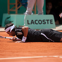 5 June 2009: Fernando Gonzalez of Chile lays down on the court during the Men's Singles Semi Final match on day thirteen of the French Open at Roland Garros in Paris, France.
