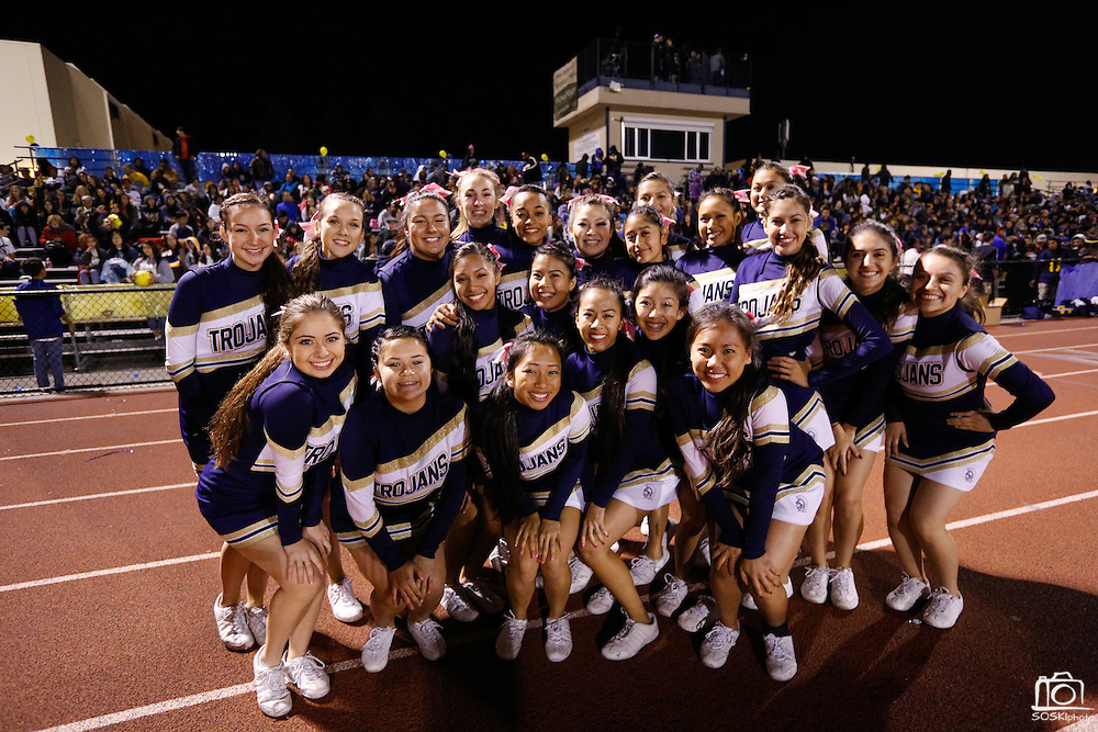 Milpitas High School cheerleaders pose for a photo during homecoming against Saratoga at Milpitas High School in Milpitas, California, on October 11, 2013.  Milpitas beat Saratoga 54-14. (Stan Olszewski/SOSKIphoto)