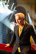 Baz Luhrmann photographed at the Picadilly Theatre in London. Baz Luhrmann is an Australian writer, director, and producer with projects spanning film, television, opera, theatre, music, and recording industries. He is regarded by many as a contemporary example of an auteur for his distinctly recognizable style and deep involvement in the writing, directing, design, and musical components of all his work. He is the most commercially successful Australian director, with four of his films in the top ten highest worldwide grossing Australian films of all time.<br /> <br /> On the screen he is best known for his Red Curtain Trilogy, comprising his romantic comedy film Strictly Ballroom (1992), the romantic tragedy William Shakespeare's Romeo + Juliet (1996), and Moulin Rouge! (2001). Following the trilogy, projects included Australia (2008), The Great Gatsby (2013), and his television limited series period drama The Get Down for Netflix.