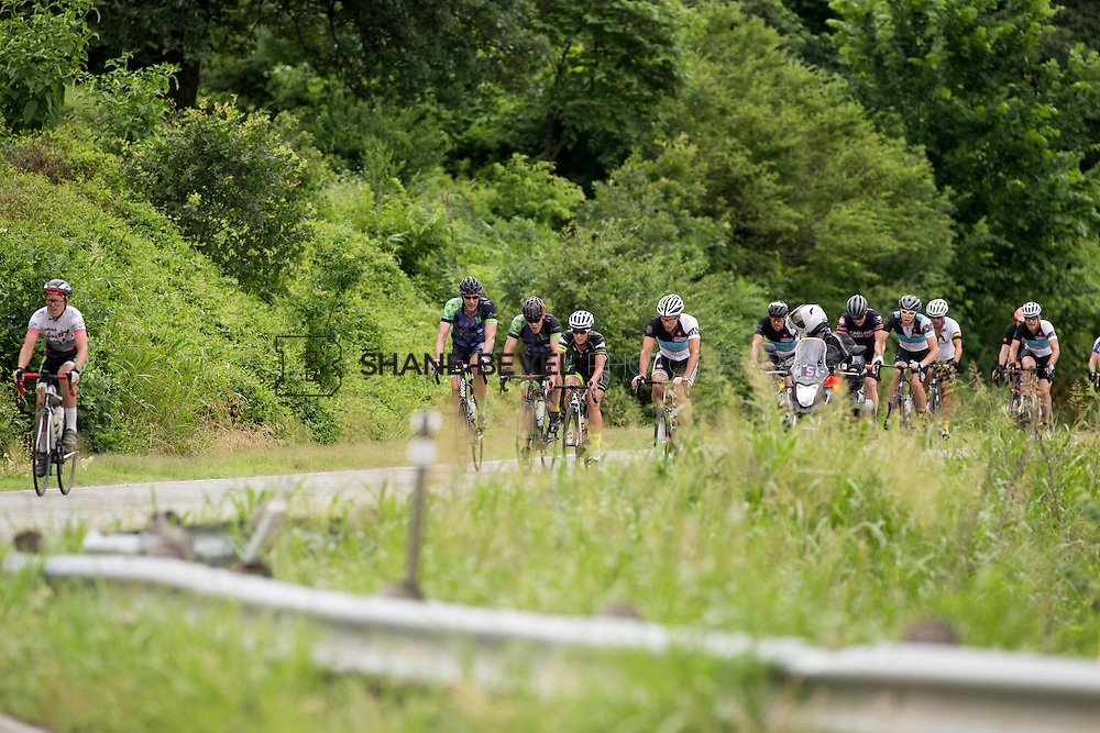 6/13/15 11:33:05 AM -- Riders pass by on their way to the top of the hill climb during the Saturday Grand Fondo Hill Climb at the Tulsa Tough rides. <br /> <br /> Photo by Shane Bevel