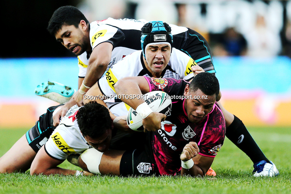 David Fusitu'a of the Warriors is tackled by Jamie Soward and Tyrone Peachey of the Panthers. Round 16 NRL Telstra Premiership game, Vodafone Warriors v Penrith Panthers, Mt Smart Stadium, Auckland, New Zealand. Sunday 29th June 2014. Photo: photosport.co.nz