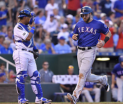 July 15, 2017 - Kansas City, MO, USA - Texas Rangers' Joey Gallo scores in front of Kansas City Royals catcher Salvador Perez on a single by Shin-Soo Choo in the ninth inning July 15, 2017 at Kauffman Stadium in Kansas City, Mo. The Rangers won, 1-0. (Credit Image: © John Sleezer/TNS via ZUMA Wire)
