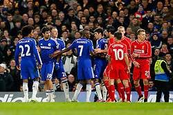 Diego Costa of Chelsea is held back by John Terry after getting into a scuffle with Martin Skrtel of Liverpool during extra time - Photo mandatory by-line: Rogan Thomson/JMP - 07966 386802 - 27/01/2015 - SPORT - FOOTBALL - London, England - Stamford Bridge - Chelsea v Liverpool - Capital One Cup Semi-Final Second Leg.