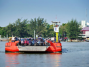 22 JANUARY 2019 - PHRA PRADAENG, SAMUT PRAKAN, THAILAND: A motorcycle and vehicle ferry that crosses the Chao Phraya River in Phra Pradaeng comes into its mooring. The use of vehicle ferries across the river has gone down as the government has built bridges to connect communities on both sides of the river. The Phra Pradaeng ferries are the busiest ferries in the Bangkok metropolitan area. Since the BTS Skytrain now stops a few kilometers from the ferry, the number of commuters going into Bangkok that use the ferry has increased.      PHOTO BY JACK KURTZ