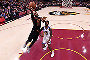 Jun 6, 2018; Cleveland, OH, USA; Cleveland Cavaliers forward LeBron James (23) shoots the ball against Golden State Warriors center Jordan Bell (2)  in game three of the 2018 NBA Finals at Quicken Loans Arena.