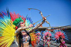 © Licensed to London News Pictures. 26/08/2019. London, UK. A performer with bow and arrow on the second day of Notting Hill Carnival in west London. Thousands of revellers take part in Notting Hill Carnival, Europe's largest street party and a celebration of Caribbean traditions and the capital's cultural diversity. Photo credit: Dinendra Haria/LNP