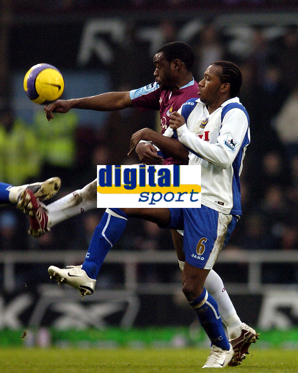 Photo: Olly Greenwood.<br />West Ham United v Portsmouth. The Barclays Premiership. 26/12/2006. West Ham's Nigel Reo Coker and Portsmouth's Glen Johnson