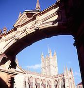View of Bath abbey under stone archway, Bath, England