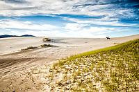 Homem cavalgando nas dunas da Praia da Joaquina. Florianópolis, Santa Catarina, Brasil. / Man riding a horse on the dunes of Joaquina Beach. Florianopolis, Santa Catarina, Brazil.