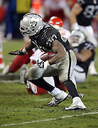Oakland Raiders running back Darren McFadden (20) runs the ball in the third quarter during the NFL week 12 regular season football game against the Kansas City Chiefs on Thursday, Nov. 20, 2014 in Oakland, Calif. The Raiders won their first game of the season 24-20. ©Paul Anthony Spinelli