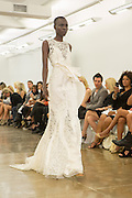 White lace sleeveless gown. By Carmen Marc Valvo at the Spring 2013 Fashion Week show in New York.