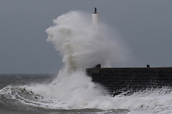 © Licensed to London News Pictures. 22/11/2017. Aberystwyth, Wales, UK. High tides and strong winds, gusting up to 50 mph, combine to bring waves crashing into the sea defences and  promenade in the early morning in Aberystwyth , on the Cardigan Bay coast of west Wales. Photo credit: Keith Morris/LNP
