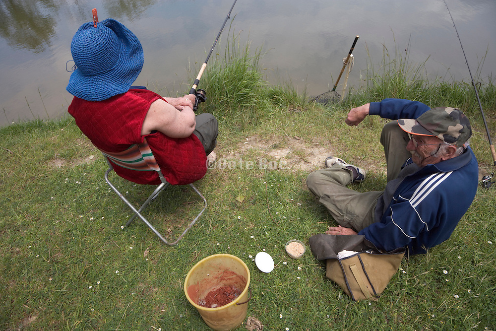 elderly couple fishing