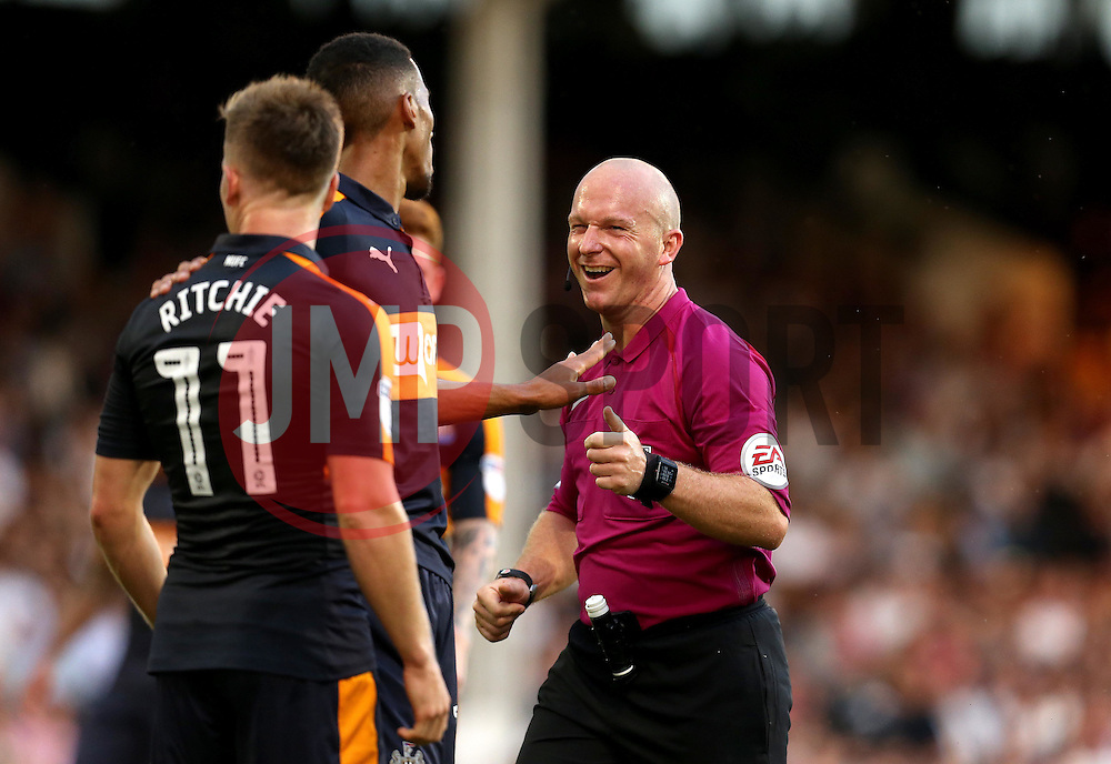 Referee Simon Hooper smiles as Newcastle United players argue with a decision - Mandatory by-line: Robbie Stephenson/JMP - 05/08/2016 - FOOTBALL - Craven Cottage - Fulham, England - Fulham v Newcastle United - Sky Bet Championship