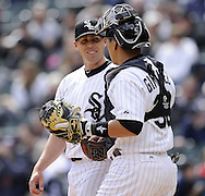 CHICAGO - APRIL 06:  Dylan Axelrod #33 smiles while talking to Hector Gimenez #38 of the Chicago White Sox durning the game against the Seattle Mariners on April 06, 2013 at U.S. Cellular Field in Chicago, Illinois.  The White Sox defeated the Mariners 4-3.  (Photo by Ron Vesely)   Subject:  Dylan Axelrod; Hector Gimenez