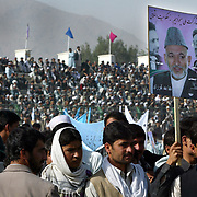 06 October 2004&#xD;&#xA;Kabul, Afghanistan.&#xD;&#xA;Afghanistan's Pesidential Election Campaign.&#xD;&#xA;&#xD;&#xA;&#xD;&#xA;With tight security provided by both National military and private contractors from Dynacorp, Afghanistans interim President Hamid Karzai attended a campaign rally held in Kabul's huge stadium. A large crowd were vocal in their support for Karzai with only days before voting takes place.<br />