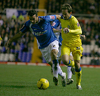 Leeds attacker Eddie Lewis (right) takes on Birmingham defender Stephen Kelly (left)