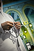 Man holds prayer beads in a mosque in United Arab Emirates, Dubai