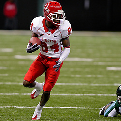 Oct 17, 2009; New Orleans, LA, USA; Houston Cougars wide receiver Kierrie Johnson (84) runs away from Tulane Green Wave defensive back Jordan Garrett (4) during a game at the Louisiana Superdome. Houston defeated Tulane 44-16.   Mandatory Credit: Derick E. Hingle-US PRESSWIRE