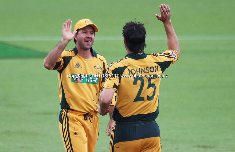 Ricky Ponting celebrates with Mitchell Johnson after Ponting ran out Daniel Vettori.<br />