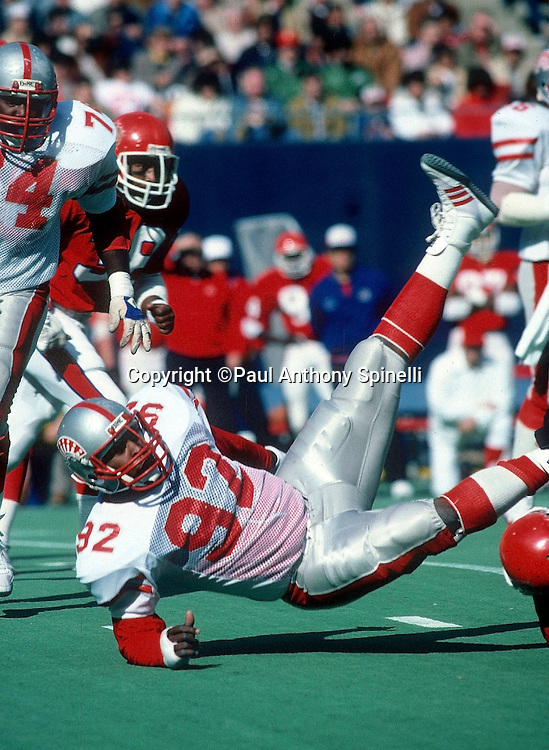 Memphis Showboats defensive end Reggie White (92) gets upended during the USFL football game against the New Jersey Generals on April 8, 1984 in East Rutherford, New Jersey. The Generals won the game 35-10. ©Paul Anthony Spinelli