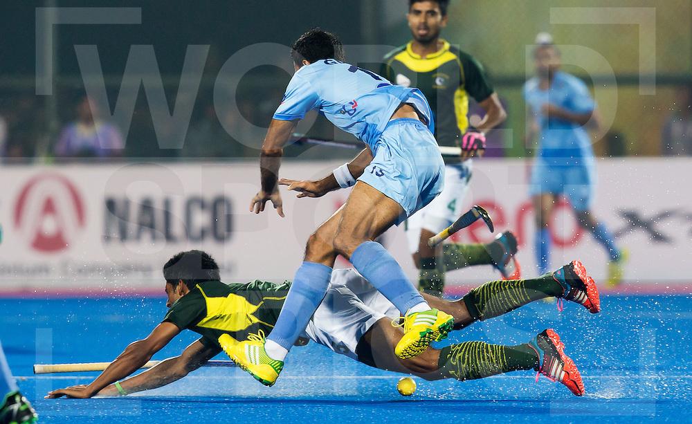 BHUBANESWAR (India) -  Hero Champions Trophy hockey men. Semifinal India vs Pakistan. Gurbaj Singh of India and Muhammad Dilber of Pakistan. Photo Koen Suyk