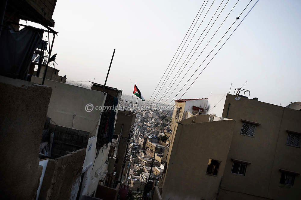 JORDAN, Amman : A Jordanian flag flies on the roof top of a house in Amman on March 31, 2011.ALESSIO ROMENZI