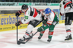 12.12.2014, Curt Fenzel Stadion, Augsburg, GER, DEL, Augsburger Panther vs Koelner Haie, 26. Runde, im Bild l-r: im Zweikampf, Aktion, mit Chris Minard #41 (Koelner Haie) und Arvids Rekis #37 (Augsburger Panther) // during Germans DEL Icehockey League 26th round match between Augsburger Panther vs Koelner Haie at the Curt Fenzel Stadion in Augsburg, Germany on 2014/12/12. EXPA Pictures © 2014, PhotoCredit: EXPA/ Eibner-Pressefoto/ Kolbert<br /> <br /> *****ATTENTION - OUT of GER*****