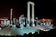 Temple of Apollo at night, 4th century BC, Didyma, Aydin, Turkey. This enormous temple complex dates from the Archaic period, but after it was destroyed by Darius I of Persia in 494 BC, it was rebuilt in the Hellenistic style in 313 BC once Alexander the Great had conquered Miletus. It originally had 122 enormous 60-foot tall Ionic columns dating to the 2nd century BC, although only 3 remain, 2 of which support the roof of the cella or inner chamber of the temple. Didyma was an ancient Greek sanctuary on the coast of Ionia near Miletus, consisting of a temple complex and the oracle of Apollo, or Didymaion, who was visited by pilgrims from across the Greek world. The earliest temple ruins found here date to the 8th century BC but Didyma's heyday lasted throughout the Hellenistic age. It was approached along a 17km Sacred Way from Miletus and is the largest sanctuary in Western Turkey. Picture by Manuel Cohen