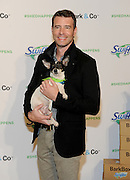 "Scott Foley holds a rescue dog at Swiffer's ""Welcome Home"" event, Thursday, Nov. 12, 2015, in New York. Foley has partnered with Swiffer to spread the word that cleaning concerns should never be an obstacle to bringing home your child's first pet.  (Photo by Diane Bondareff/Invision for Swiffer/AP Images)"