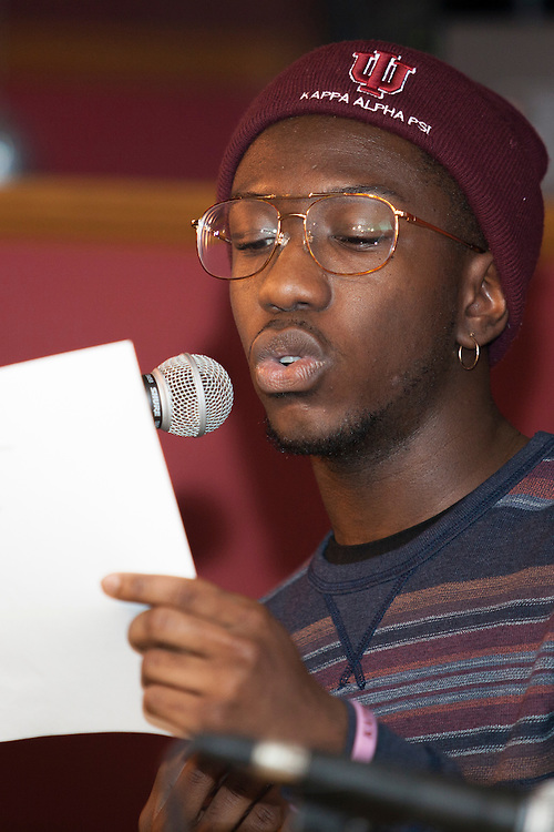 "Marcus Cole reads an original poem at ""Creative Arts as Activism – Social Justice-Themed Open Mic Night,"" at Casa Nueva Restaurant and Cantina on January 20, 2016. Cole said he wrote the poem in a creative writing class. ©Ohio University/Photo by Kaitlin Owens"